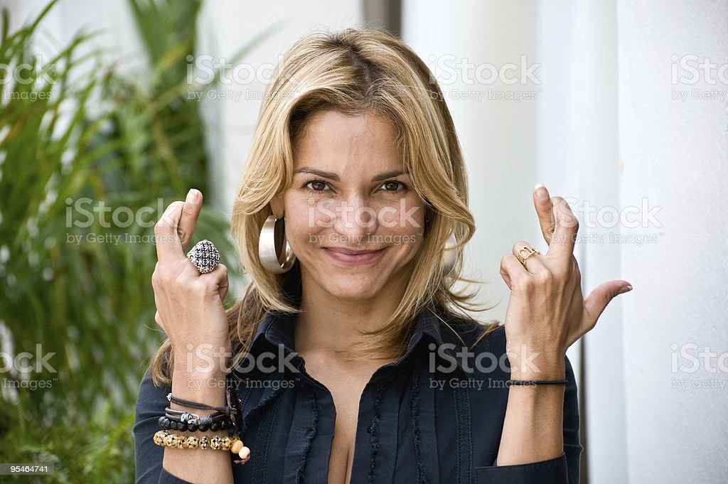 Crossing her fingers royalty-free stock photo
