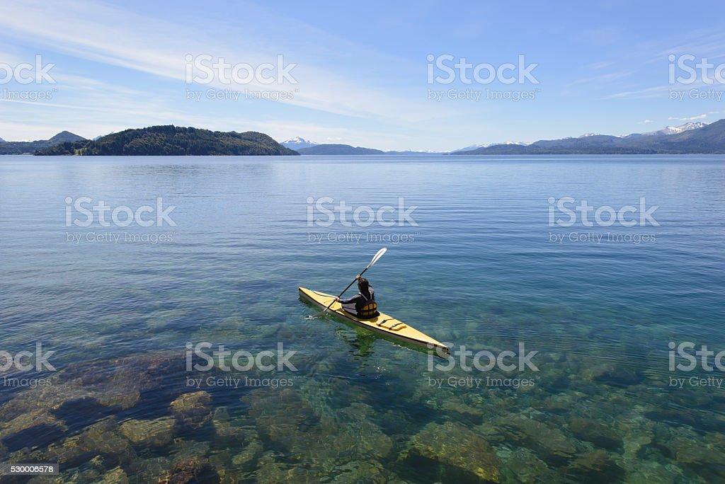 Crossing Kayak Paddling the Lakes of Patagonia, Argentina. stock photo