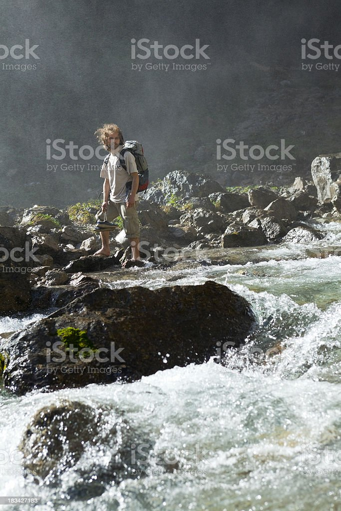 crossing mountain river royalty-free stock photo