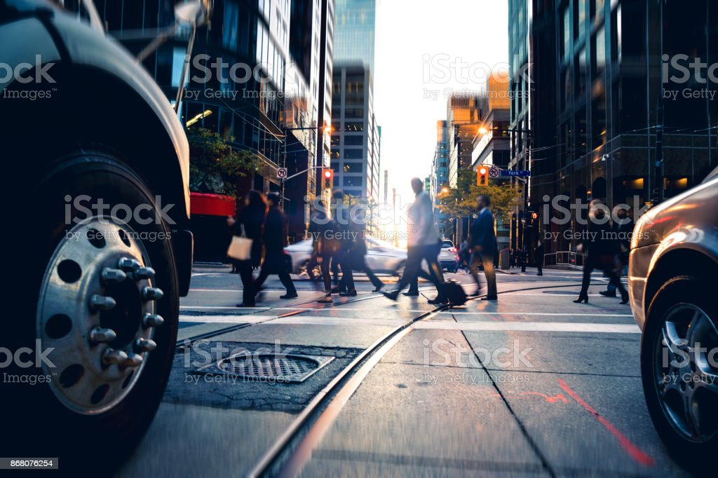 Crossing people - traffic at rush hour stock photo