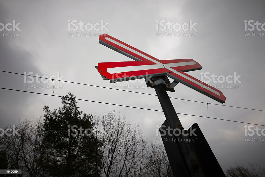 Crossing sign and storm cloud stock photo