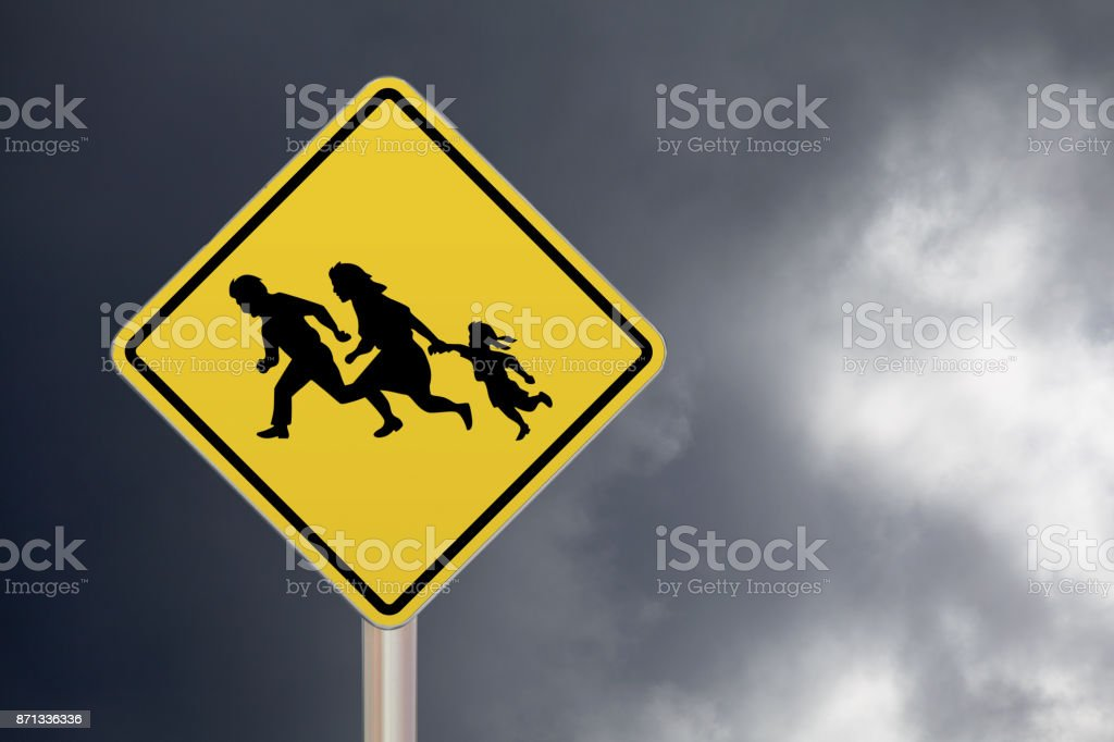 Crossing sign - Illegal migrants stock photo