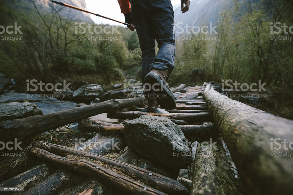 Crossing the footbridge in Himalayas stock photo