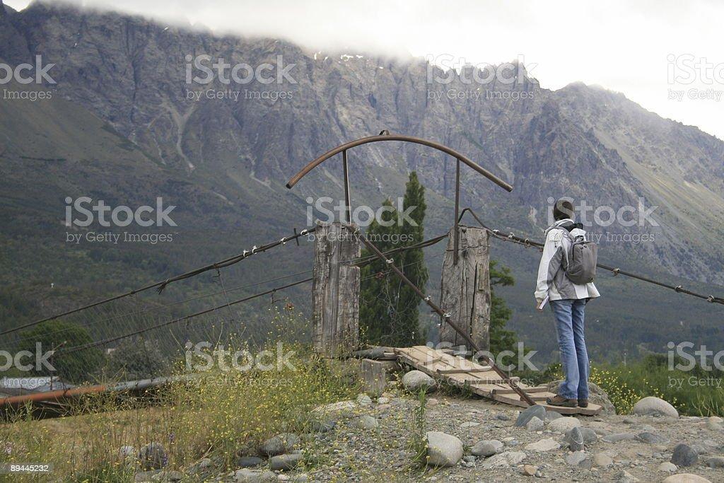 Crossing the hang bridge royalty-free stock photo