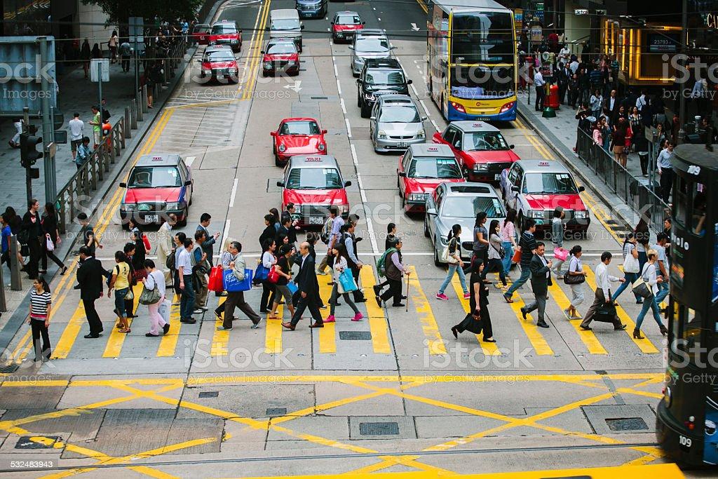 Crossing the road, Central, Hong Kong stock photo