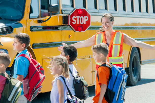 crossing the road - school bus stock photos and pictures
