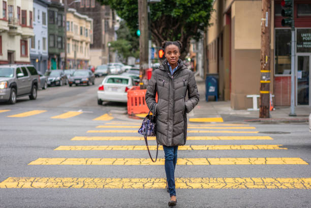 Crossing the street in San Francisco's Mission District stock photo