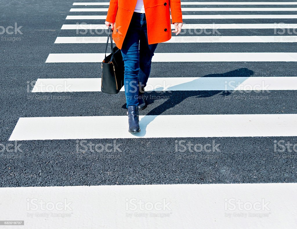 crossing the street stock photo