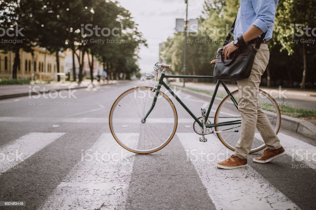 Crossing the Street with the bicycle stock photo