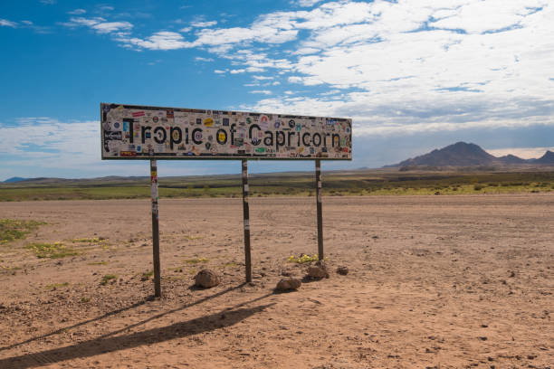 Crossing the tropic of Caprocorn  on  the road in the Nambib desert, between Sossusvlei and Swakopmund, Namibia Crossing the tropic of Caprocorn  on  the road in the Nambib desert, between Sossusvlei and Swakopmund, Namibia antipode stock pictures, royalty-free photos & images