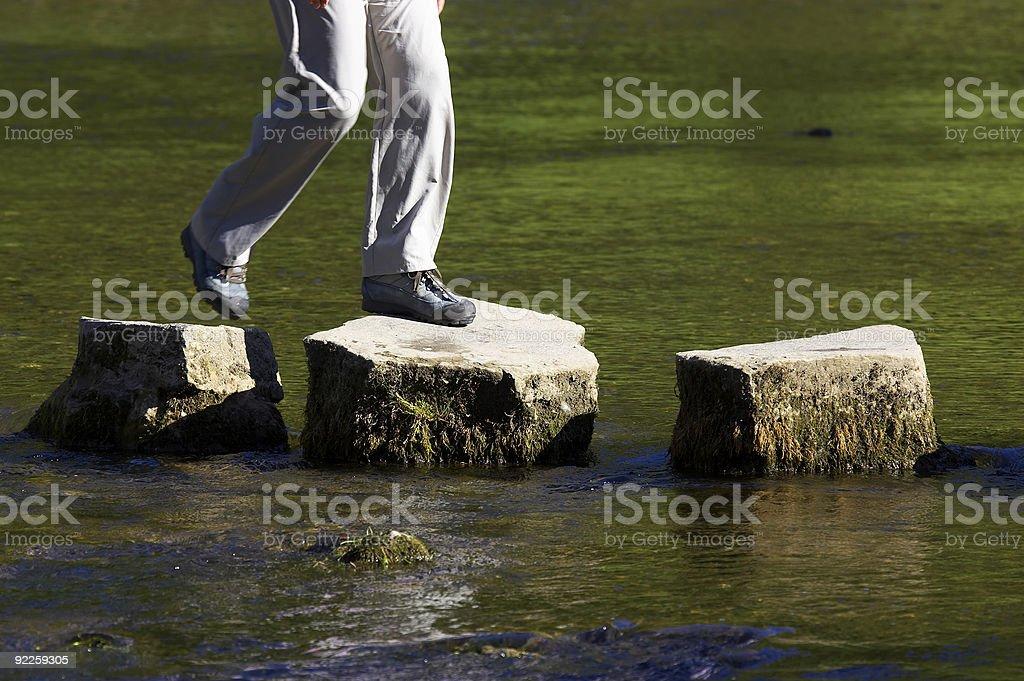crossing three stepping stones stock photo