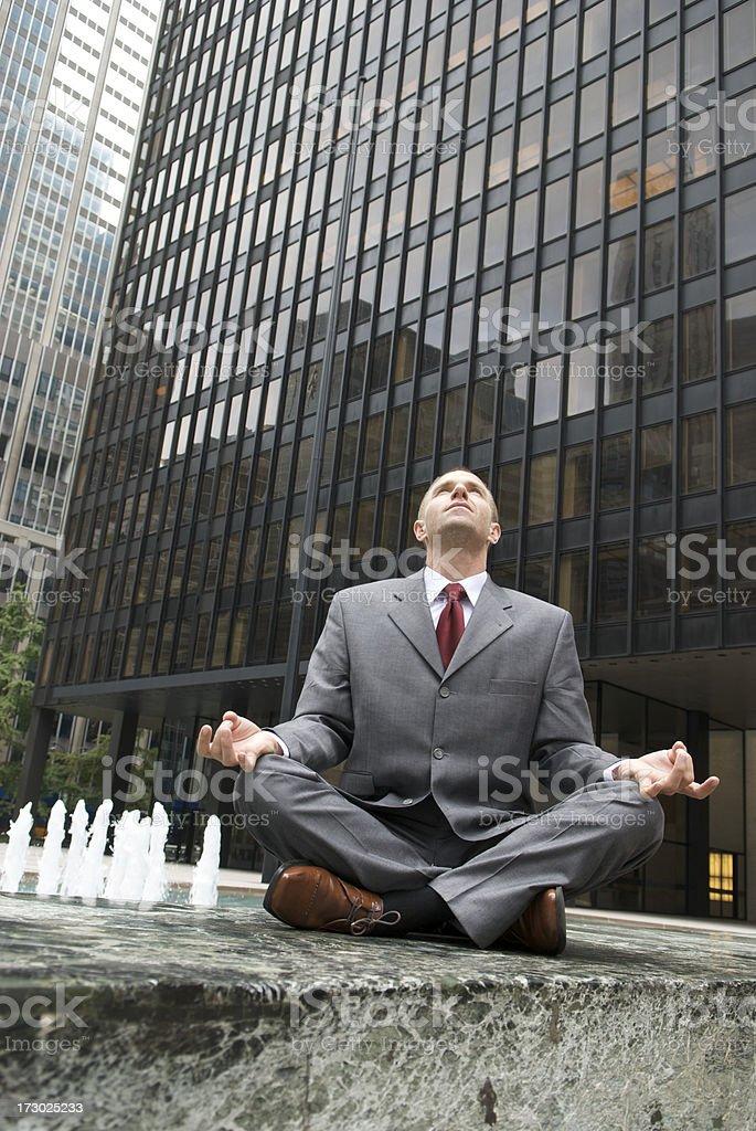 Cross-Legged Businessman Looks Skyward royalty-free stock photo