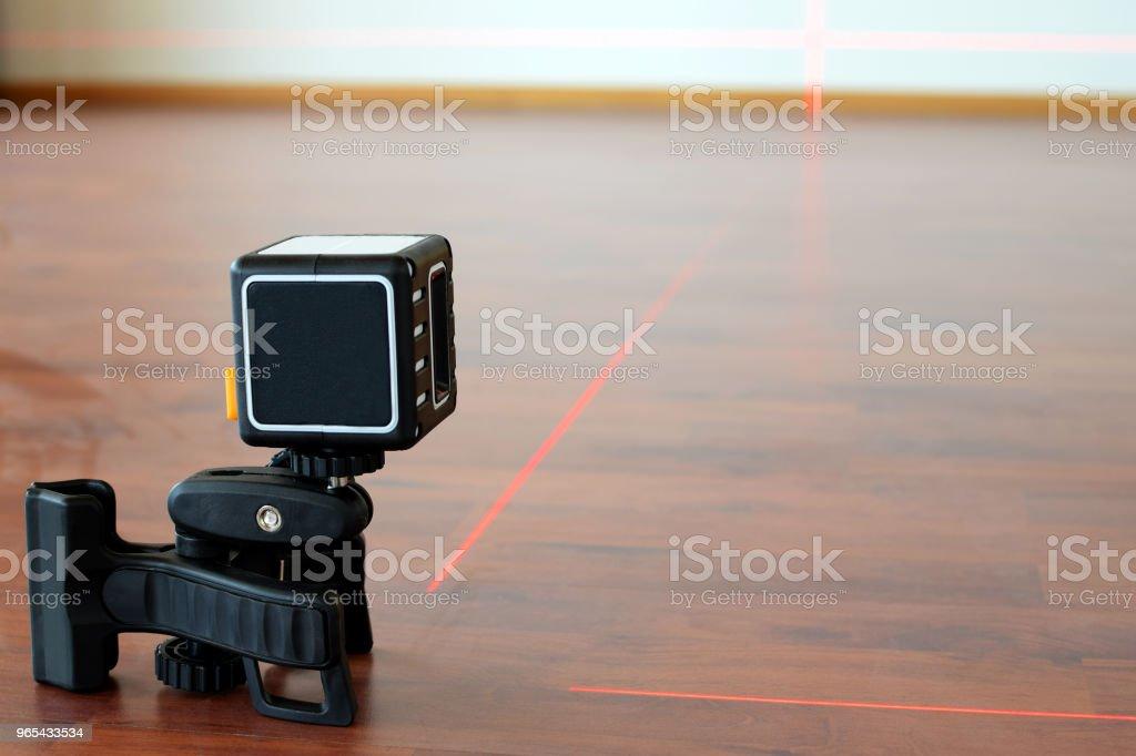 Cross-line laser on the floor zbiór zdjęć royalty-free
