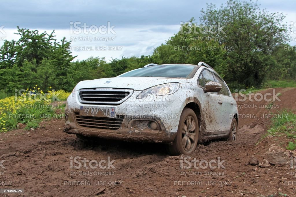 Crossover on the muddy road stock photo