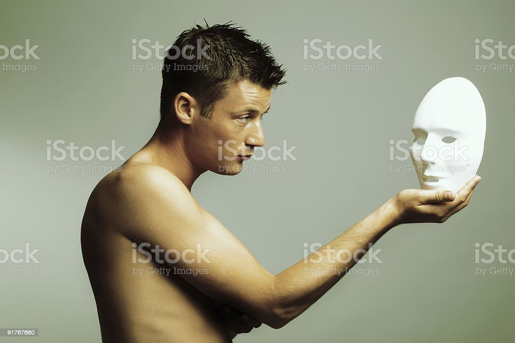 cross-processed fine art portrait of young man with mask royalty-free stock photo
