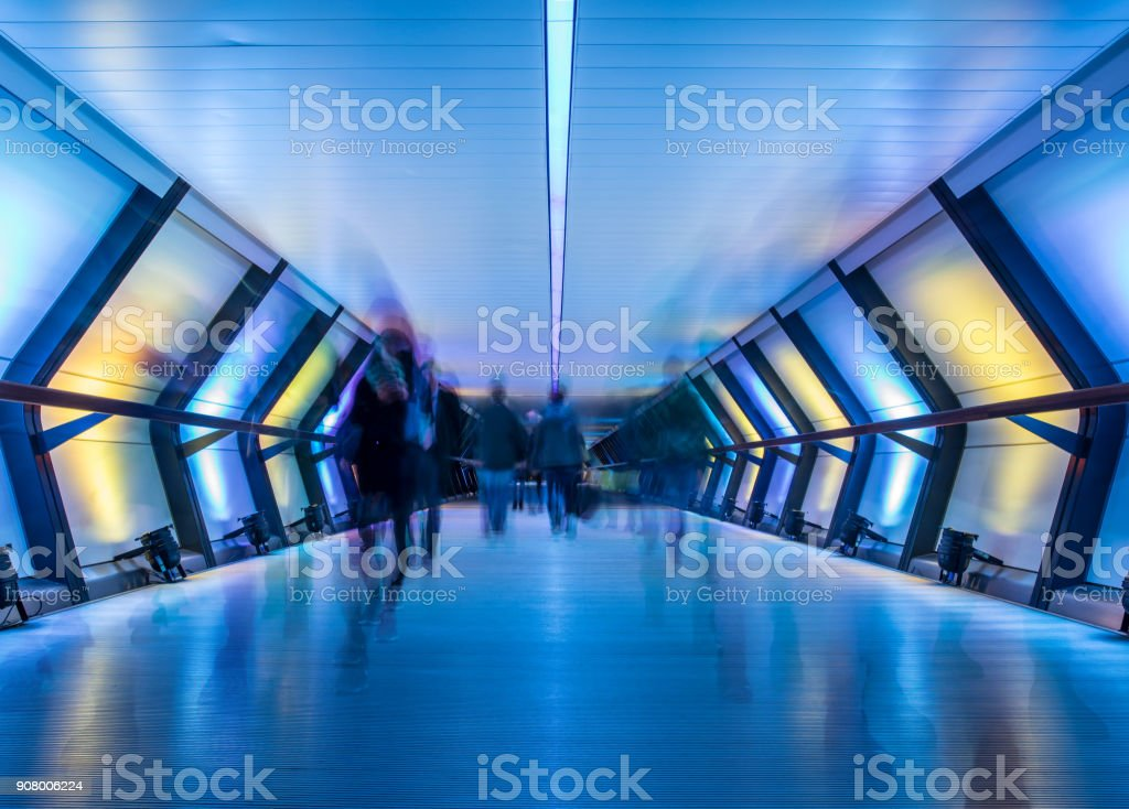Crossrail with people in blurred motion, Canary Wharf, London, UK stock photo