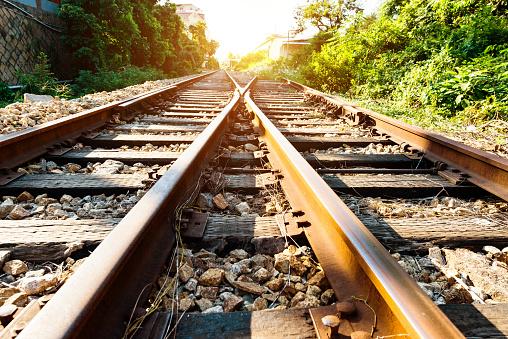 Crossroad railroad track at sunset