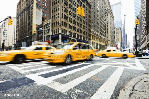 New York Manhattan street with speeding motion blurred taxis - yellow cabs. Manhattan, New York City, USA.