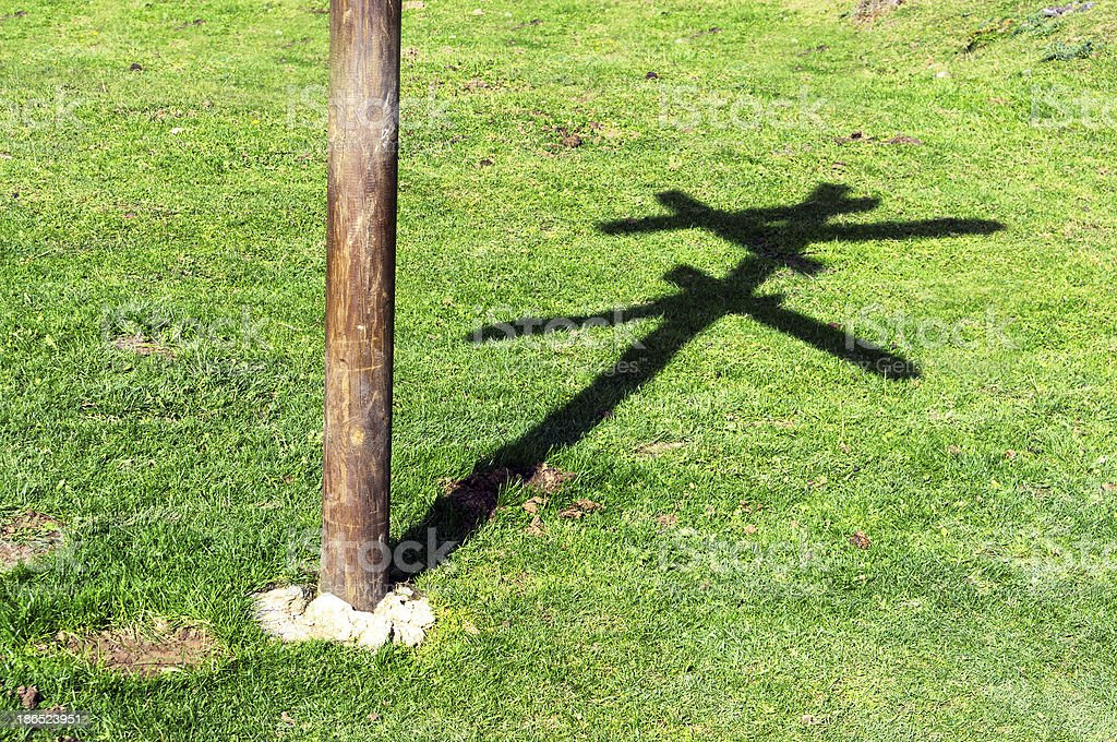 crossroad with the shadow of wooden signpost royalty-free stock photo