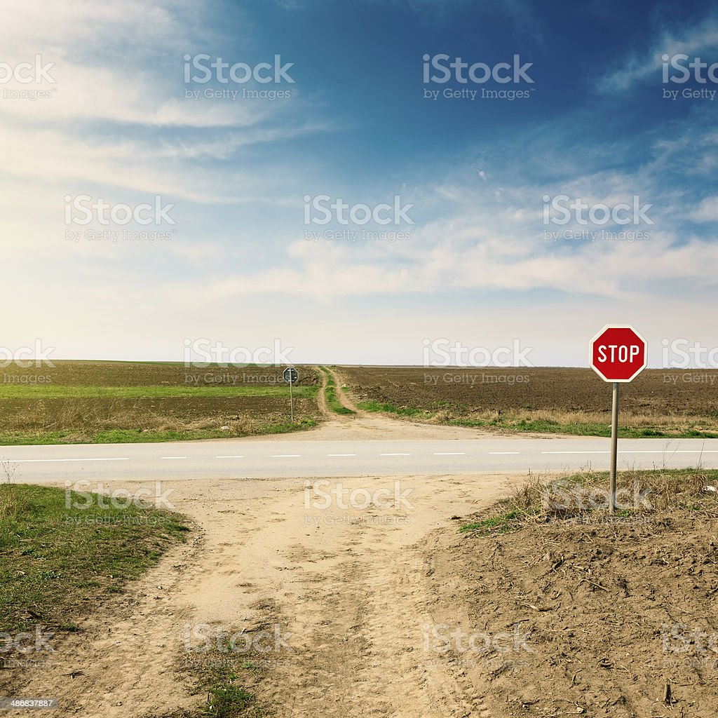 Crossroad with warning sign for priority road stock photo