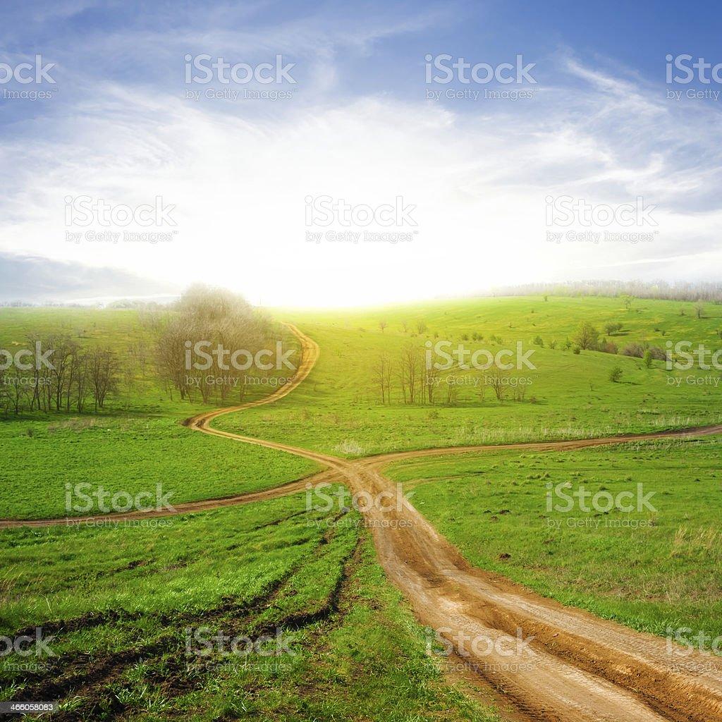 crossroads among a green fields stock photo
