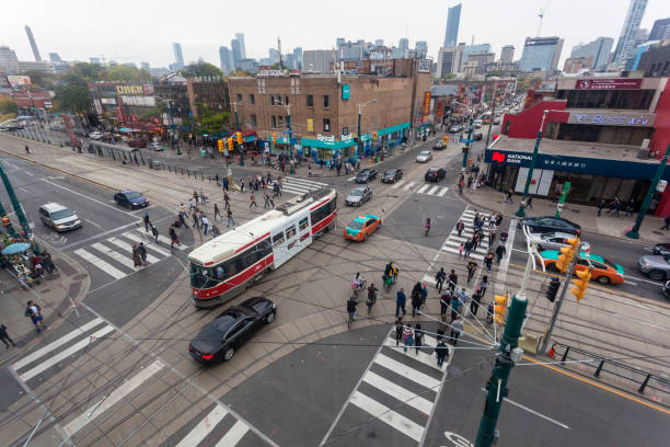crossroads in the city of toronto, canada - toronto streetcar stock photos and pictures