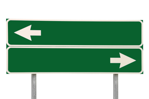 istock Crossroads Road Sign, Two Arrows Green Isolated Blank Empty Signage 185884645