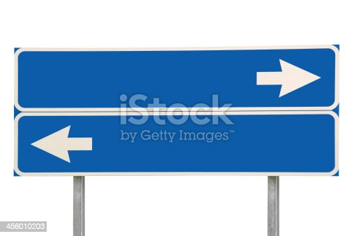 185884645 istock photo Crossroads Road Sign, White Arrows Blue Background, Isolated Copy Space 456010203
