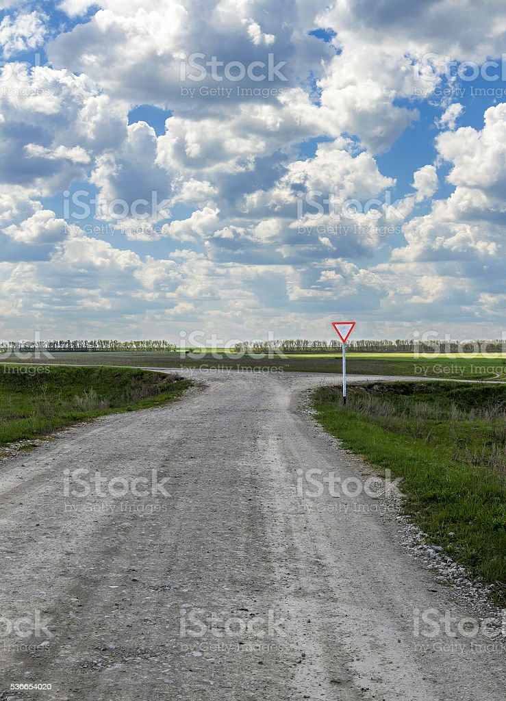 Crossroads rural roads and main stock photo