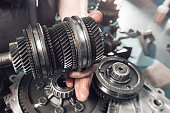 istock Cross-section of a car gearbox. mechanic work in the garage 696749978