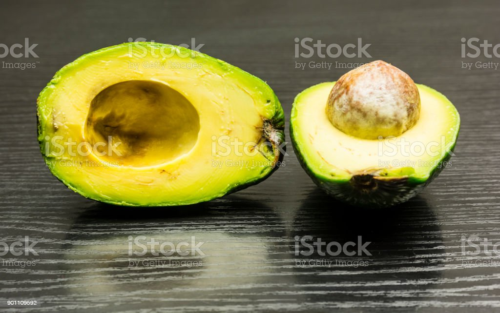 A cross-section of a ripe avocado. stock photo