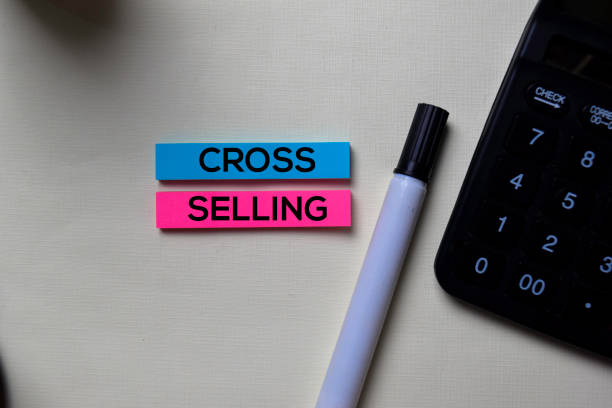 Cross-Selling text on sticky notes isolated on office desk stock photo