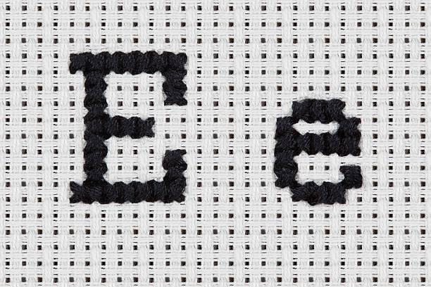 Cross-stitch - Alphabet and Icons: Ee stock photo