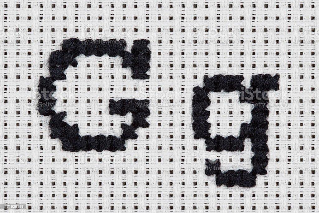 Cross-stitch - Alphabet and Icons: Gg stock photo