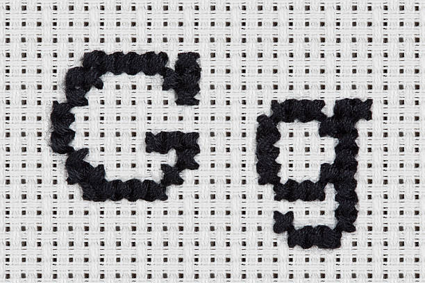 Cross-stitch - Alphabet and Icons: Gg stock photo