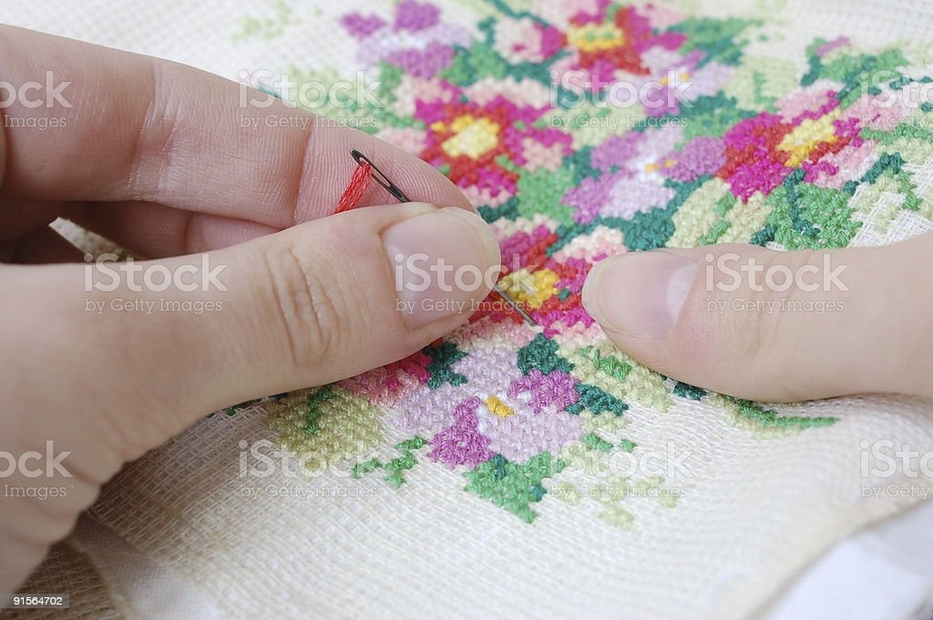 Cross-stitch embroidery stock photo