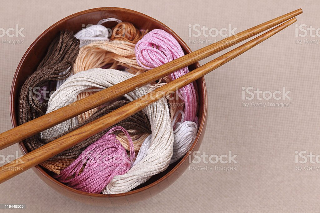 Cross-Stitch threads in a bowl with chopsticks royalty-free stock photo