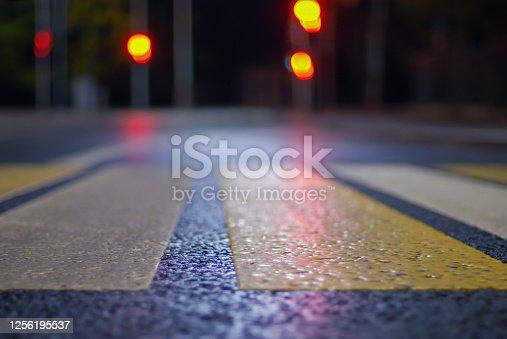 crosswalk at night street, blurred   traffic lights, defocused city background