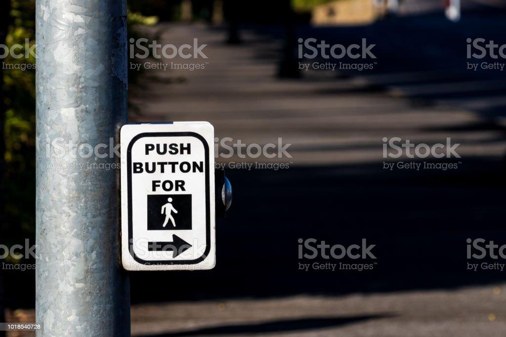 Crosswalk button mechanism on a steel post stock photo