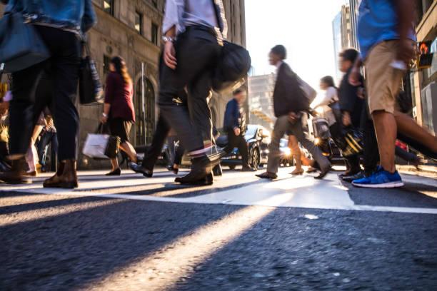 Crosswalk, people crossing in downtown stock photo