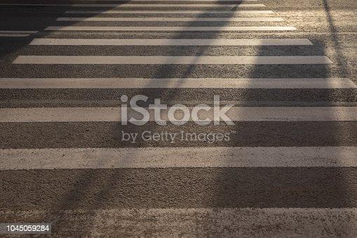 Perspective of White crosswalk on asphalt road zebra