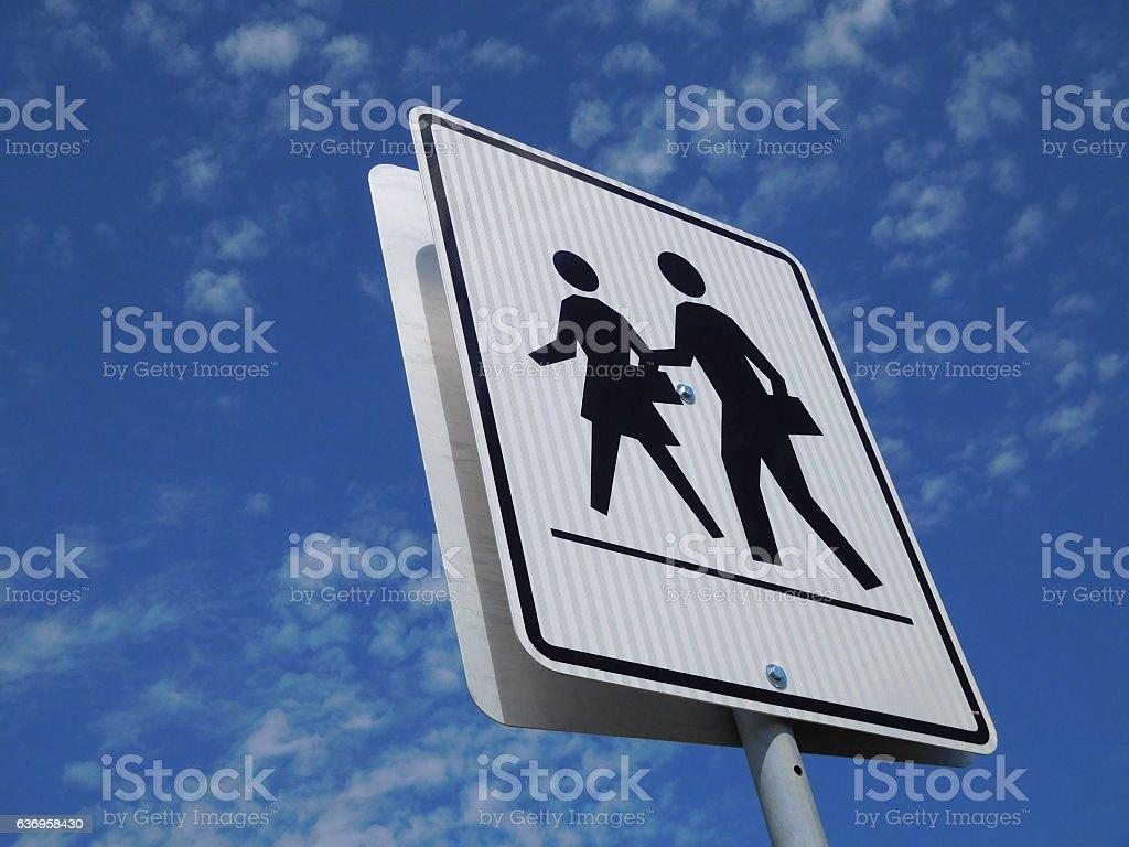 Crosswalk Sign Near School stock photo