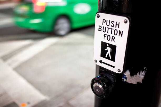 Crosswalk Sign With Green Car Speeding By stock photo
