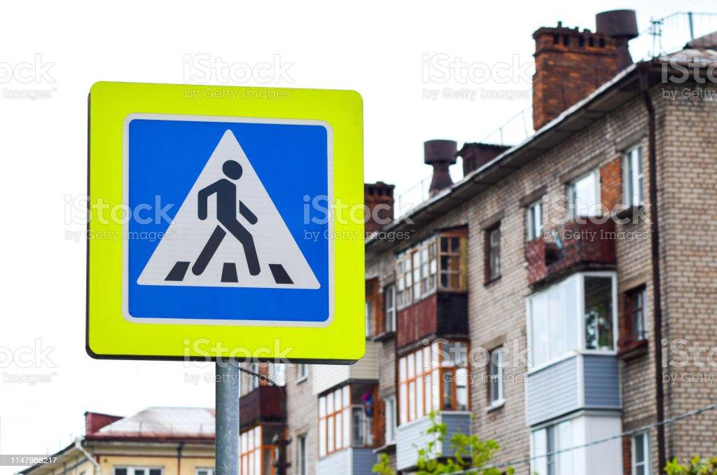 Crosswalk traffic sign in the urban background