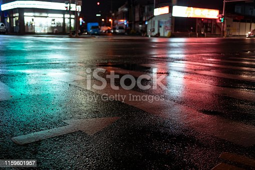 istock Crosswalk with pointing arrow in the night in neon light. 1159601957