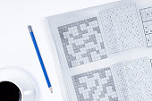 istock crossword  paper with coffee and pen 1212388828
