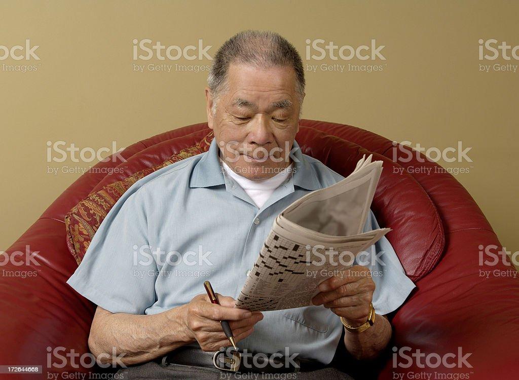 Crossword perusal stock photo