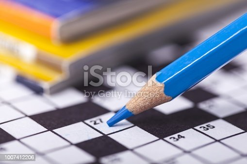 Closeup of crossword puzzle and pencil. Conceptual image of problem solving