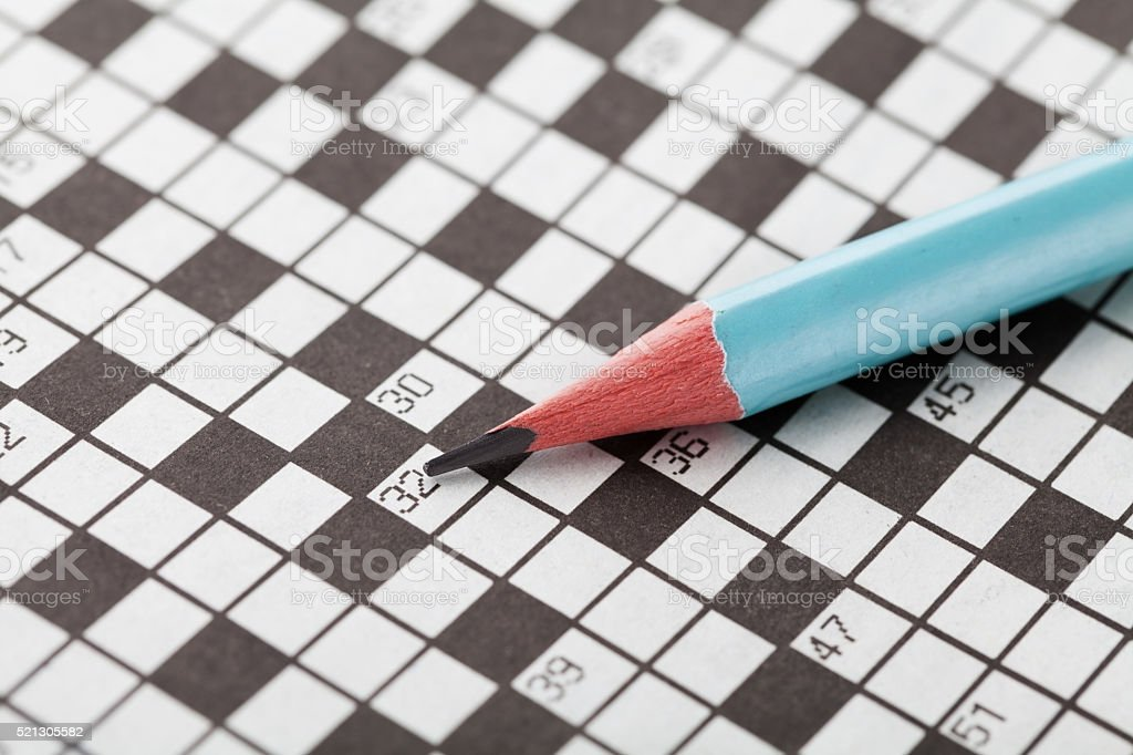 Crossword puzzle and blue pencil stock photo