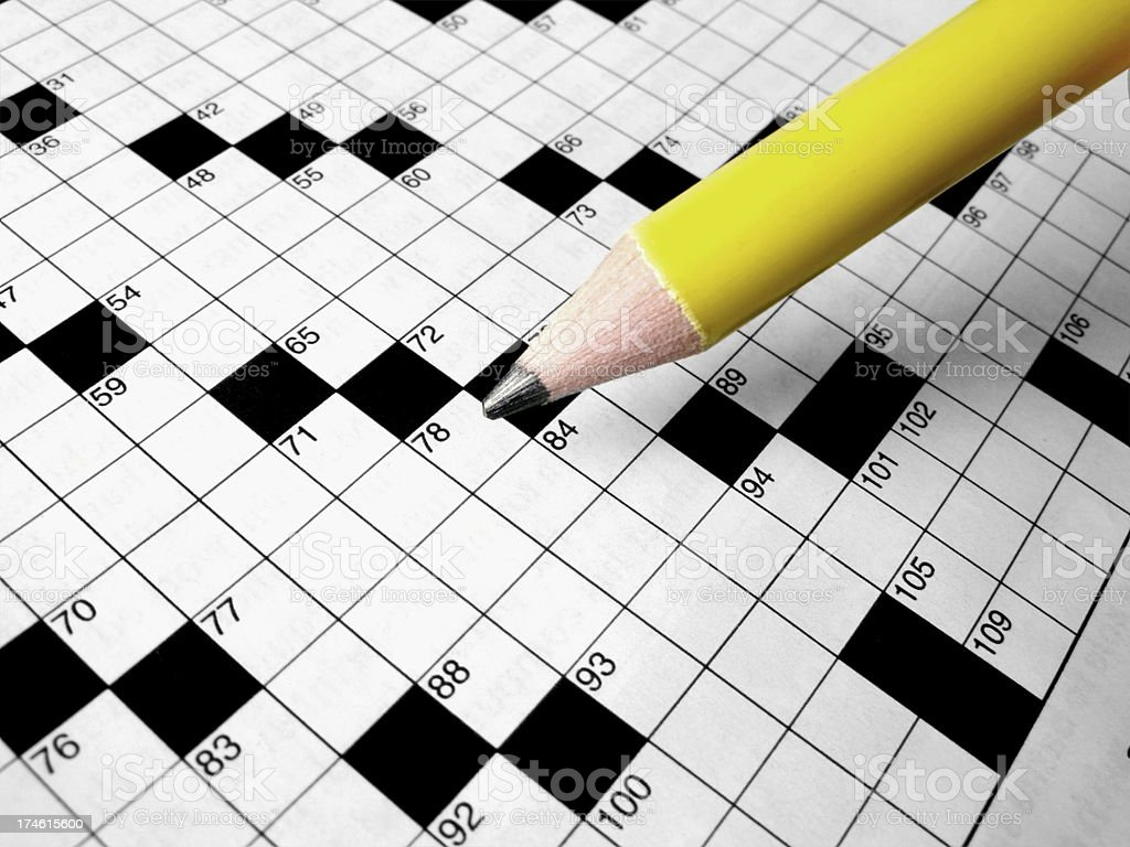 Crossword Puzzle and Pencil stock photo